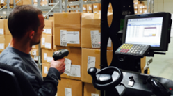 Warehouse worker use barcode scanner at IC Groups warehouse