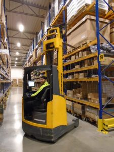 Warehouse worker operates truck at KW Bruun