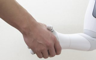 Human and robotic shaking hands