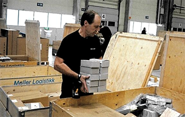 Warehouse Operator Per Hermansson in the process of packing a large shipment for one of the dealers.