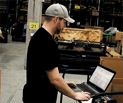 Warehouse Operator Tom Steinar Håland receives deliveries using the Astro WMS (M2) office client