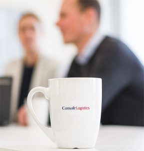 Consafe Logistics coffee mug with people talking in the background
