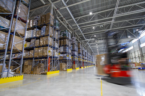red forklift moving in a warehouse