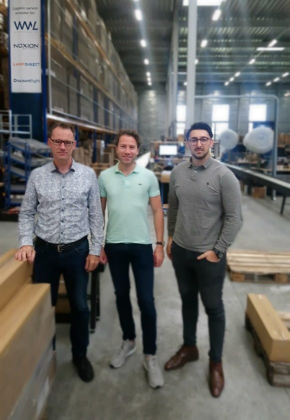 Three colleagues standing in Picpac warehouse