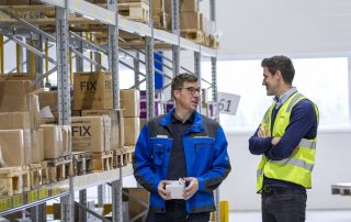 Two men discussing inside the warehouse of isiflo