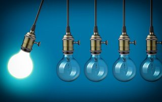 light bulbs hanging from the ceiling with blue background