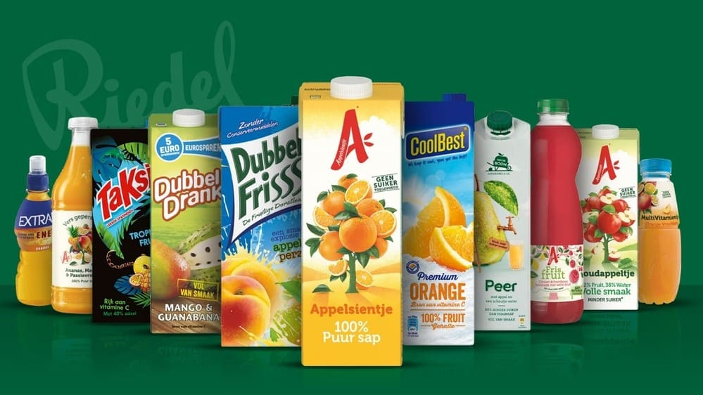 Riedel press release photo - different juice packages in different colours with a green background